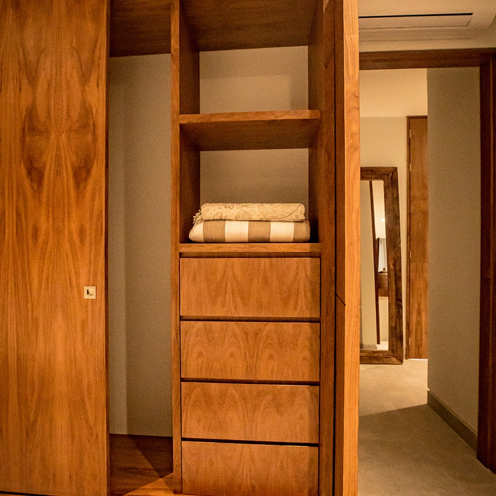 Bed room with wooden wardrobe